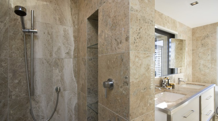View of the master bathroom with floor-to-ceiling marble, bathroom, floor, flooring, interior design, room, tile, wall, gray, brown