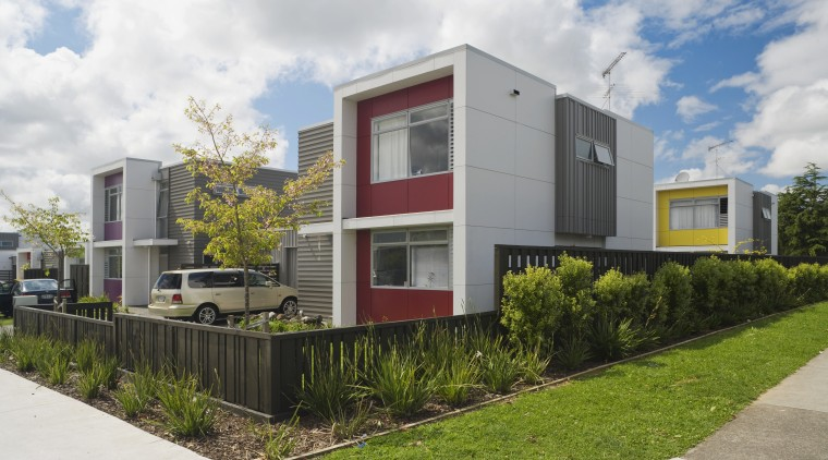 This Housing New Zealand Devlopment features modular homes, architecture, corporate headquarters, elevation, facade, home, house, neighbourhood, property, real estate, residential area, white