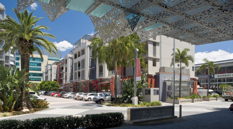 View of the Emporium precinct which is part architecture, arecales, building, city, condominium, downtown, metropolitan area, mixed use, neighbourhood, palm tree, plant, plaza, real estate, residential area, sky, tree, black