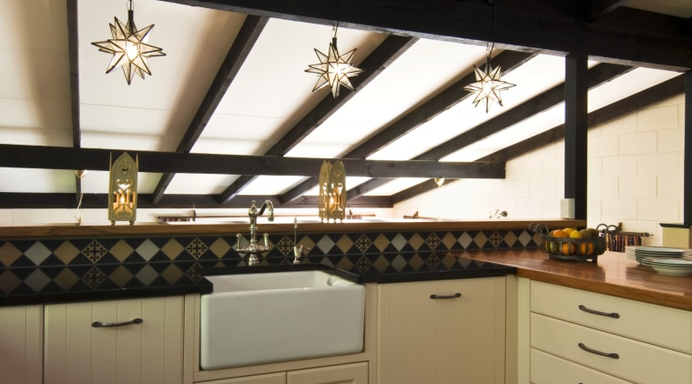 Image of kitchen designed by Debra DeLorenzo which cabinetry, ceiling, countertop, cuisine classique, daylighting, floor, interior design, kitchen, room, under cabinet lighting, wood, brown