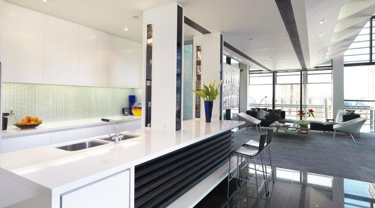 Image of this sleek modern kitchen which has countertop, interior design, kitchen, real estate, white