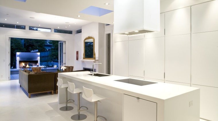 View of kitchen which features a kitchen island countertop, interior design, kitchen, product design, room, white