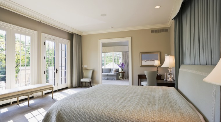 View of master bedroom which features bedroom furnishings, bedroom, ceiling, estate, floor, home, interior design, property, real estate, room, suite, window, gray