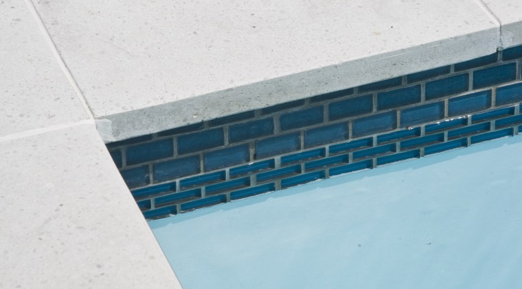 View of the pool tiling and paving. aqua, azure, blue, daytime, floor, line, reflection, sea, sky, swimming pool, turquoise, water, teal, white