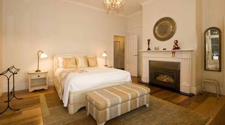 View of bedroom with chandelier, wooden flooring, rug, bed frame, bedroom, ceiling, estate, furniture, home, interior design, property, real estate, room, suite, orange, brown