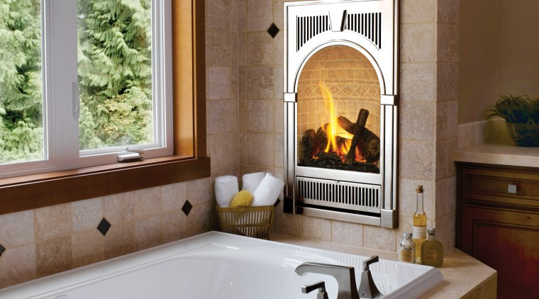 Image of bath tub which features Bed & fireplace, hearth, home, interior design, living room, room, window, wood burning stove, brown, gray
