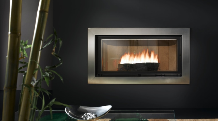 View of heat-efficient fireplace with cherry blossom surround fireplace, hearth, heat, wood burning stove, black