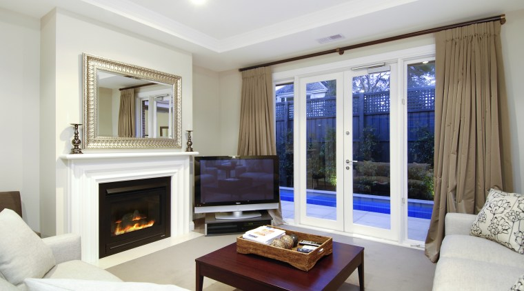 View of the living area of a home ceiling, interior design, living room, property, real estate, room, window, white