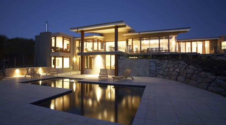 Exterior view of a family home designed and apartment, architecture, elevation, estate, facade, home, house, landscape lighting, lighting, mansion, official residence, property, real estate, residential area, swimming pool, villa, blue