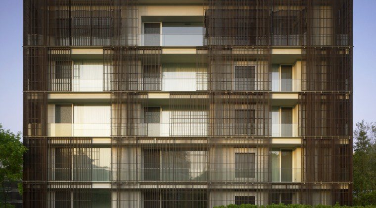 Exterior view of an apartment building which features apartment, architecture, building, commercial building, condominium, corporate headquarters, elevation, facade, headquarters, house, mixed use, real estate, residential area, window, brown