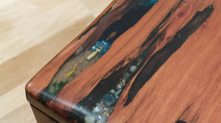 View of a table created by Ironwood Antique hardwood, wood, wood stain, red, orange