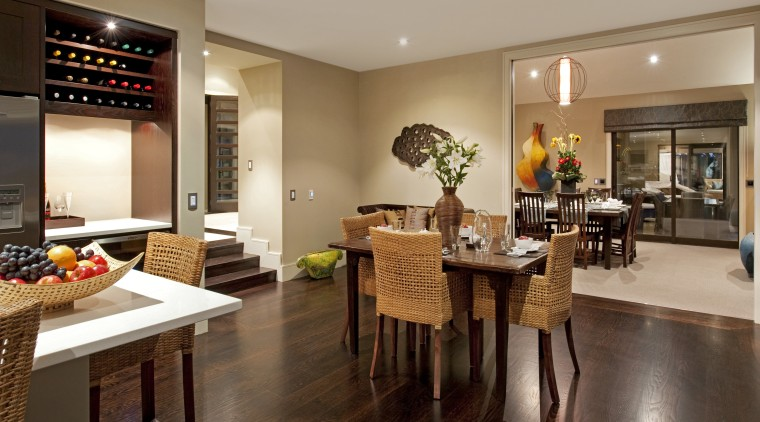 View of the open-plan kitchen and dining area dining room, flooring, interior design, kitchen, real estate, room, brown, orange