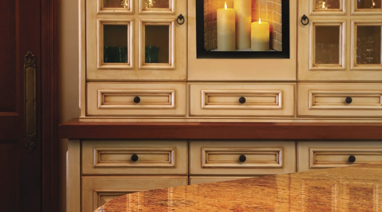 View of the Illuminations electric Fireplace by Fireplace cabinetry, countertop, cuisine classique, floor, flooring, furniture, hardwood, home, home appliance, interior design, kitchen, room, under cabinet lighting, wood flooring, wood stain, orange, brown, red