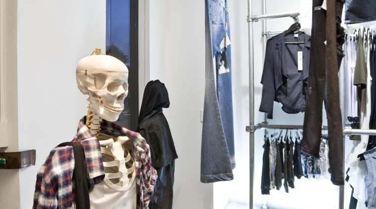 View of clothing displays at the Black Box boutique, fashion, outerwear, white