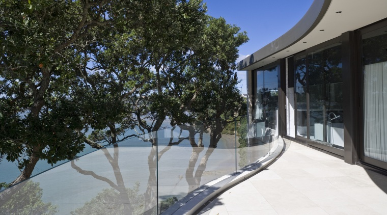Exterior view of A Waterside house made of architecture, estate, home, house, plant, property, real estate, tree, black, gray