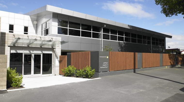 Exterior view of the redeveloped Kakariki House by architecture, building, commercial building, corporate headquarters, facade, property, real estate, residential area, gray