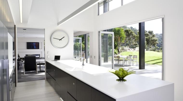 View of kitchen featuring large island, dark-stained oak architecture, house, interior design, kitchen, real estate, window, white
