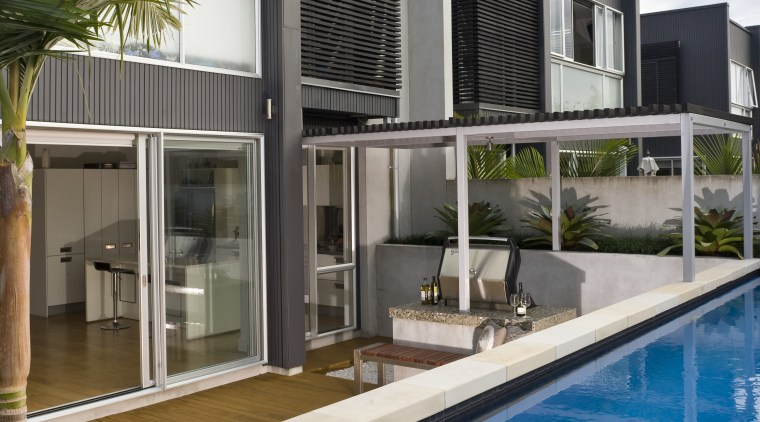 View of outdoor entertaining area and pool which apartment, architecture, building, condominium, estate, facade, home, house, property, real estate, swimming pool, villa, window