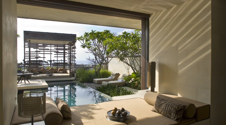 Borrowed from the landscape, this villas soft interior architecture, condominium, estate, home, house, interior design, living room, property, real estate, swimming pool, window, brown