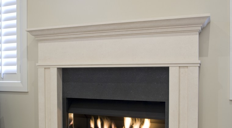 View of a hand-crafted stone mantle by The fireplace, hearth, gray