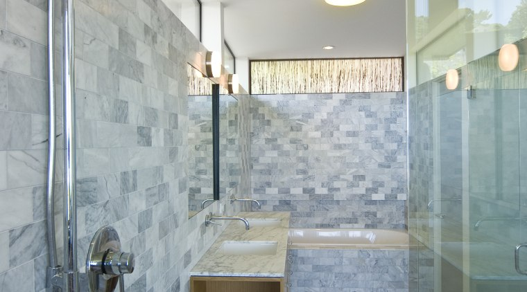 This bathroom features a marble tiled shower enclosure architecture, bathroom, ceiling, daylighting, floor, home, interior design, plumbing fixture, real estate, room, tile, wall, gray