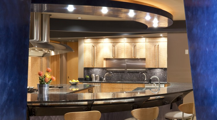 View of a kitchen which features a U-shaped ceiling, interior design, lighting, lobby, table, wall, blue