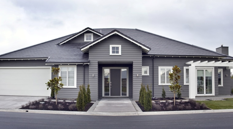Exterior view of a Landmark Homes show home building, cottage, elevation, estate, facade, home, house, neighbourhood, property, real estate, residential area, siding, suburb, white, gray