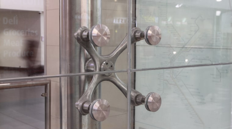 View of the front of a railway station glass, gray