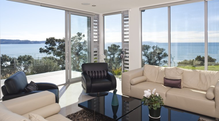 interior lounge view of a Cliff top house, estate, house, interior design, living room, penthouse apartment, property, real estate, window, gray
