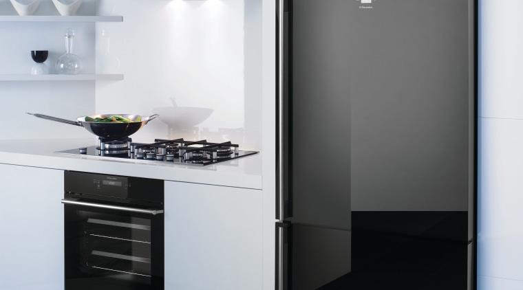 View of a kitchen which features a refrigerator, home appliance, interior design, kitchen, kitchen appliance, kitchen stove, major appliance, product, product design, refrigerator, white, black