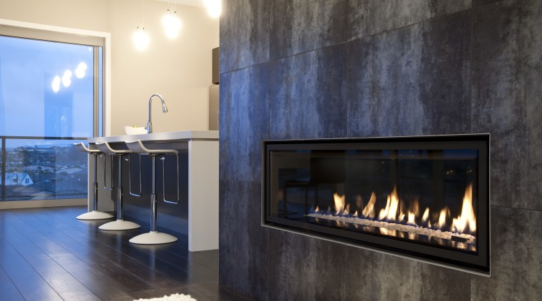 interior view of the New David Reid show fireplace, hearth, interior design, wood burning stove, black