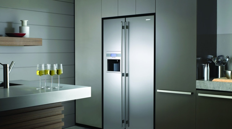 View of a kitchen which features a refrigerator home appliance, major appliance, refrigerator, gray, black