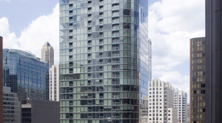 View of 600 North Fairbanks in Chicago. apartment, architecture, building, city, cityscape, commercial building, condominium, corporate headquarters, daytime, downtown, facade, headquarters, metropolis, metropolitan area, mixed use, neighbourhood, residential area, sky, skyline, skyscraper, tower, tower block, urban area, white, gray