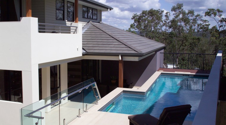 Exterior pool view of the Augusta home. Built estate, home, house, property, real estate, roof, swimming pool, villa, window, white, black