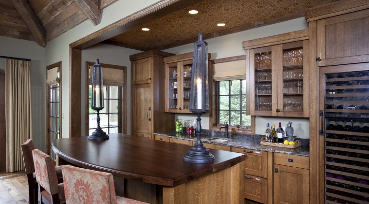 Exposed wood beams with metal strapping enhance the cabinetry, countertop, cuisine classique, estate, hardwood, interior design, kitchen, real estate, room, wood, brown