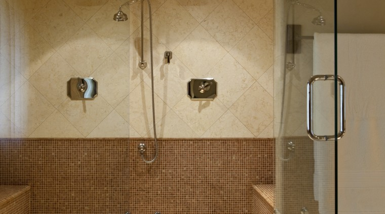 View of a bathroom which features shower enclosure architecture, bathroom, floor, interior design, plumbing fixture, room, shower, tile, brown, orange