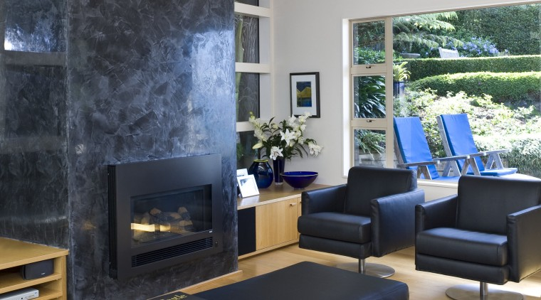 This is a lounge with the fire place couch, furniture, home, interior design, living room, room, table, wall, gray, black