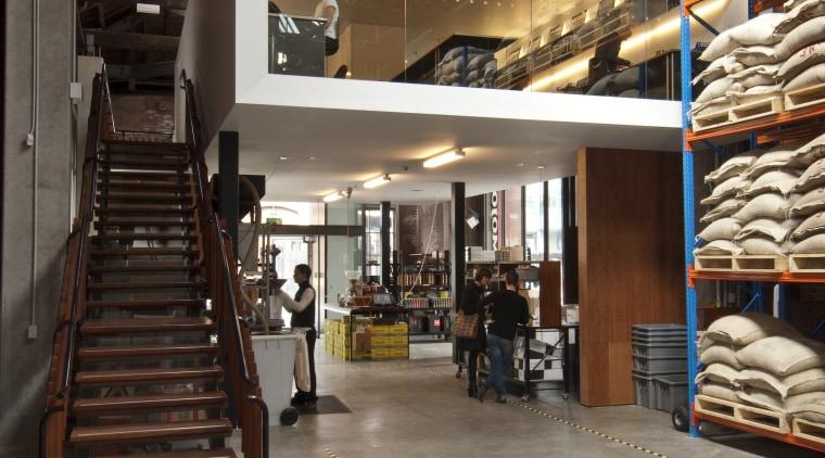View of the new Mojo Coffee Holdings headquarters floor, flooring, interior design, lobby, warehouse, wood, gray