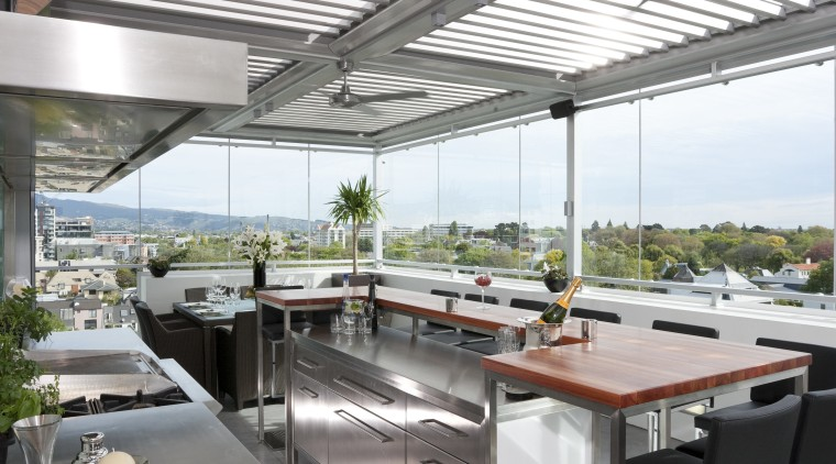The commercial look of the kitchen is reinforced daylighting, interior design, real estate, roof, white, gray