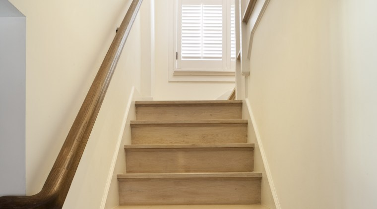 Bottom of the stairway features timber railings & daylighting, floor, handrail, hardwood, home, house, property, stairs, wood, white