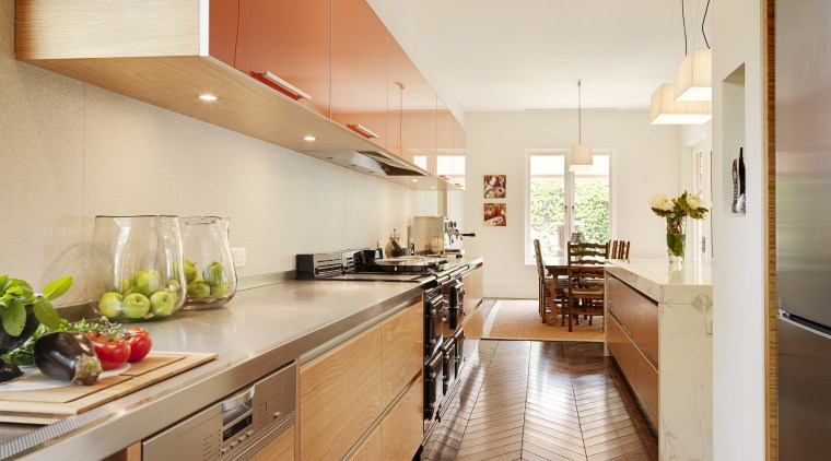 Kitchen designer Keith Sheedy worked in close contact architecture, cabinetry, ceiling, countertop, cuisine classique, floor, flooring, hardwood, interior design, interior designer, kitchen, laminate flooring, real estate, room, wood flooring, orange