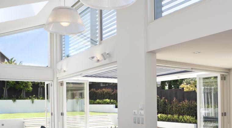 A kitchen interior designed by Anna Welsh MDINZ, ceiling, daylighting, house, interior design, kitchen, light fixture, lighting, window, gray, white