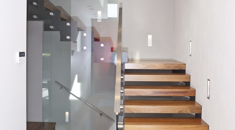 View of th entrance and stairwell. ceiling, daylighting, floor, flooring, glass, handrail, hardwood, interior design, laminate flooring, stairs, wall, wood, wood flooring, white