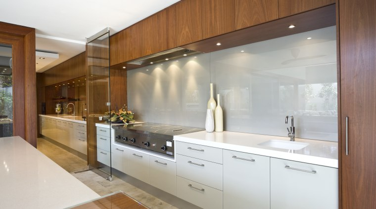 View of kitchen featuring teak cabinetry, Gaggenau oven cabinetry, countertop, cuisine classique, home, interior design, kitchen, real estate, room, brown, white, gray