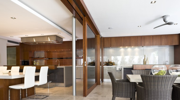 View of indoor and outdoor kitchens. ceiling, interior design, real estate, restaurant, white