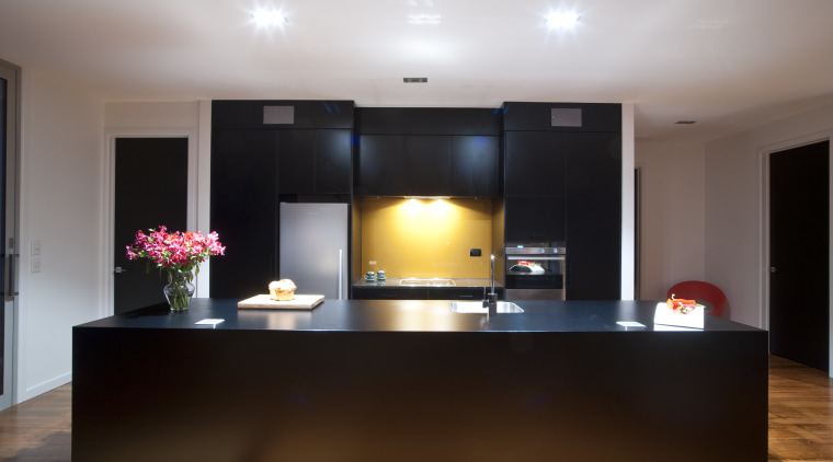 This new kitchen designed by Nicola Mason of ceiling, flooring, furniture, interior design, lighting, real estate, room, table, gray, black, brown