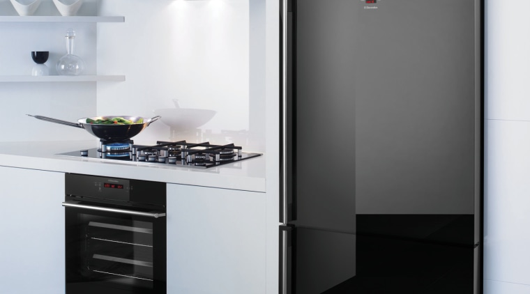 This chic kitchen features a bottom-mount refrigerator, oven, home appliance, kitchen, kitchen appliance, kitchen stove, major appliance, product, product design, refrigerator, white, black
