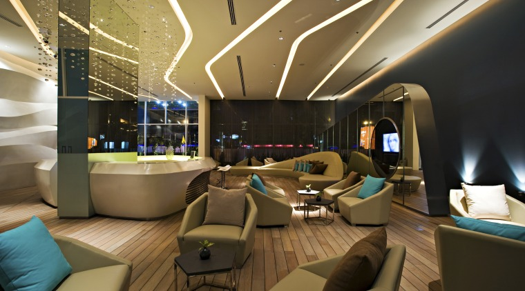 View of hotel check in area with bar ceiling, interior design, lobby, brown