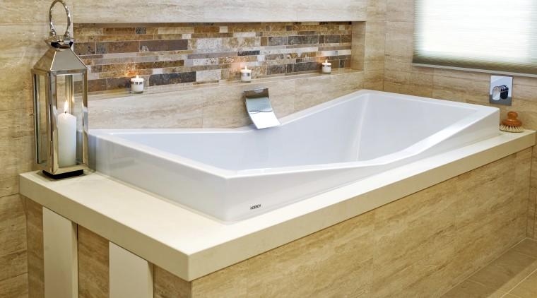Close up view of this unique bathtub surrounded bathroom, bathroom sink, bathtub, countertop, floor, flooring, interior design, plumbing fixture, product design, sink, tap, tile, white, brown