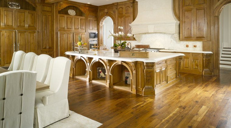 View of classical kitchen & dining area with cabinetry, countertop, cuisine classique, floor, flooring, furniture, hardwood, home, interior design, kitchen, laminate flooring, room, table, wood, wood flooring, brown, white